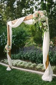 Backyard Wedding Decor Ideas For The Most Insta Worthy Nuptials Sorry Diy Thesorrygirls Drapes Wood Photobooth Photoshoot Summer Flower Girls Arbor Arch Floral