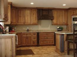 large rustic kitchen cabinet with granite countertops