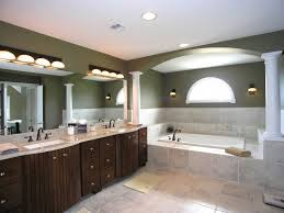 traditional bathroom lighting ideas white free standin. Bathroom Decorating Ideas For Master With Solid Wood Vanity And Traditional Lighting White Free Standin T