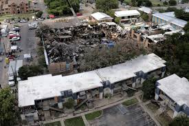 1of 9a drone operating at a distance from the scene of the fire captured this view of the iconic village apartments in san marcos