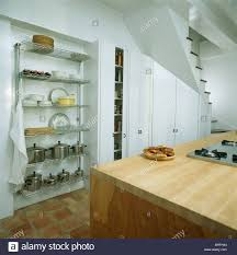 Kitchen Alcove Steel Pans And White Bowls On Glass Shelves In Alcove In Modern