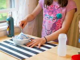 mixing color into homemade puffy paint