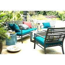 crate and outdoor furniture patio with blue cushions absurd barrel sofa harbor singapore