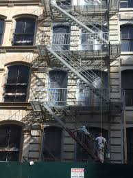 fire escape painting nyc on broome street new york