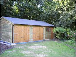 triple garage doors inspire winchester 30 ft wide timber range garden retreat howards
