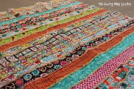 How to Make a Fabric Strip Rag Quilt - The Crafty Blog Stalker & Learn how to sew a simple fabric strip rag quilt using jelly rolls. An easy Adamdwight.com