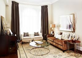 focal upright living room modern with accent pillows area rug brown brown curtains brown sofa