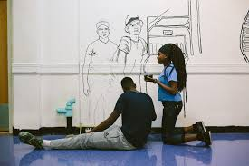 in photos students ldquo not suspects rdquo paint in protest school stories collegiate freshman lola 14 and junior dante tyson 16 paint the outline