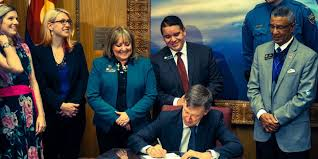 Bill benefiting families of fallen officers and state employees signed into  law