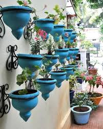 Creative hanging planters with summer flowers