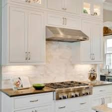 white shaker cabinets with quartz countertops. white shaker cabinets pair with marble kitchen backsplash quartz countertops