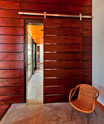 Contemporary Entry Door With Rain Screenstyle Fir Wood Panels Sliding Door  And Dark Wood