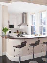 Example of a transitional u-shaped enclosed kitchen design in Boston with  stainless steel appliances