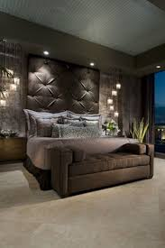 Color: Brown  Brown headboard, bench, and bedding in bedroom