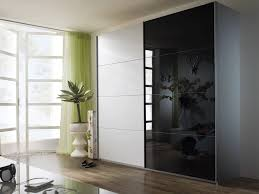 white and black sliding glass door wardrobe design together with green fabric curtain and large window