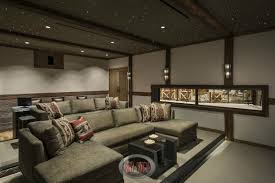 themed family rooms interior home theater: view of the luxury home theater room from the front showcasing the stadium seating design incorporating