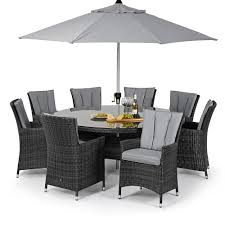 a5f295b0 e17f 46c5 a9b9 147bbe2d1017 random 2 round rattan garden table and chairs