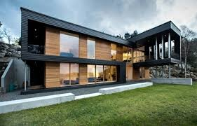 19 Examples Of Modern Scandinavian House Designs | Multiple wood clad  structures feature black framed windows
