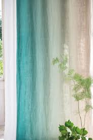 Nab yourself a cheap and cheerful set of white curtains, choose a pretty  coloured dye and make a knockout design feature for your home