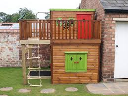 wooden playhouse with shutters