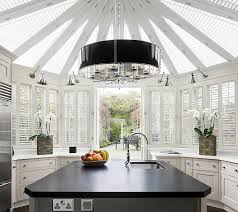 view in gallery grand chandelier accentuates the color scheme here view in gallery gorgeous chandelier enlivens the black and white kitchen
