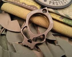 sharp brass knuckles. raidops titanium edc sharp brass knuckles h