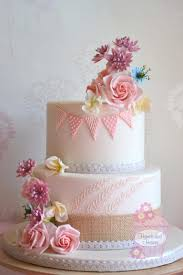 Wedding Cake Decorated With Sugar Bunting And Sugar Flowers Blush