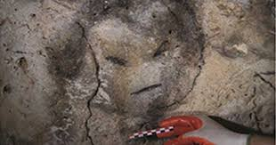 charcoal drawn face from a cave in mona puerto rico