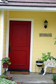 yellow houses with red doors google search
