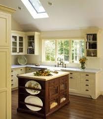 Beautiful pale yellow kitchen with hardwood floors.