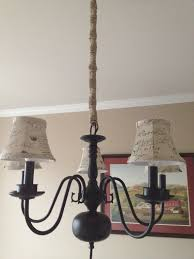 turn an ugly brass chandelier into rustic chic using spray paint