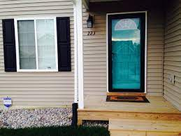 A black door is an enduring classic and definitely one of the best front door paint colors. Added A Black Storm Door To Accent Our Black Shutters Door Color Is Nifty Turquoise By Sherwin Williams Door Color Doors Exterior Brick