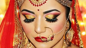 indian bridal makeup tutorial dramatic gold glitter cut crease and rich red lipstick