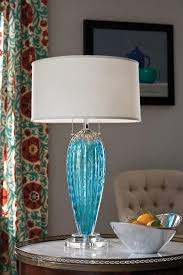 gorgeous hand blown blue murano glass lamp vibrant room setting with blue venetian glass