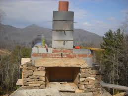 look for a long stone to be a lintel over the firebox or learn to build an arch future post or you can put a piece of steel to support the stone