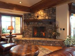 Immaculate Stacked Stone Fireplace With Wooden Mantel As Well As Brown  Leather Sofas And Rounded Table In Rustic Living Room Furnishings Decors