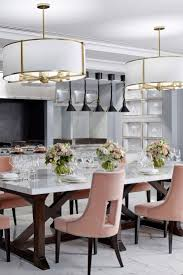 featuring a three metre white calacatta marble tabletop with high back royal salmon chairs positioned in the middle of the chef s private kitchen