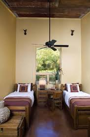 Small Bedroom With Two Beds Small Bedroom For Two Beds With Hign Ceiling And Rustic Furniture