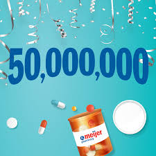 50 million free prescriptions image with confetti and meijer pharmacy pill bottle