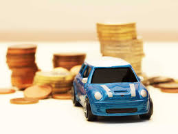 miniature mini with piles of coins