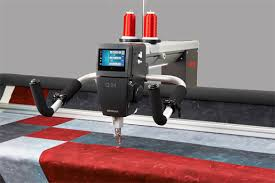 Ten Features of the BERNINA Q24 Longarm Quilting Machine in an ... & BERNINA Q24 close up with red and grey quilt---handles up Adamdwight.com