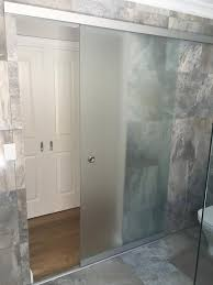 glass sliding door entry system with etched privacy finish in glass design