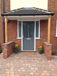 front door shelter style painted in gallant grey by porch canopy supported winter