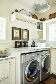 washer and dryer countertop classic cottage laundry room features a white and gray granite positioned over washer and dryer countertop