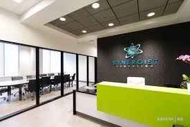 office reception office reception area. office reception area with custom desk green accents black framed glass walls