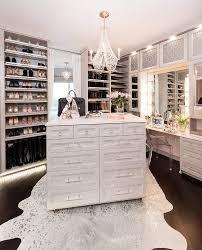 light gray closet island with white metallic cowhide rug