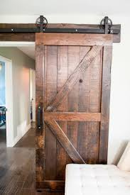 fantastic barn door authentic look great hardware beautiful patina and stain a super exle of an interior barn door