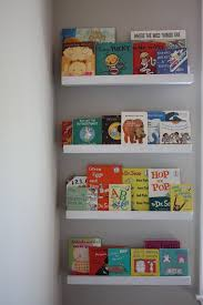 diy picture book ledge may be the perfect solution for part of that awkwardly long wall in the guest room