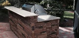 our stacked stone and stucco outdoor kitchens are custom built using heavy gage aluminum square tubing to provide lasting strength and durability