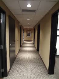 medical office decorating ideas. hallway of medical office with carpet custom stained oak doors and recessed can lighting decorating ideas